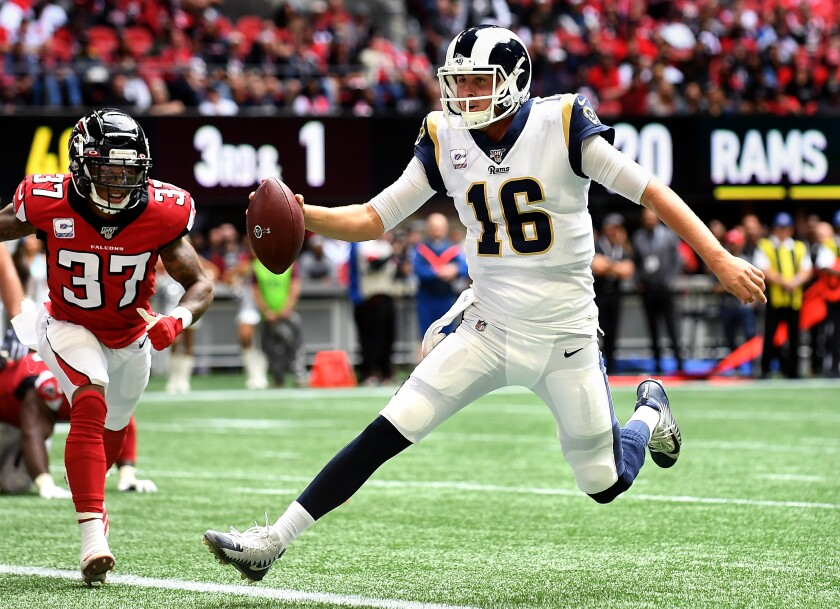 Quarterback Jared Goff scores a touchdown during the Rams' victory over the Falcons on Sunday.