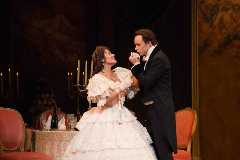"""In this June 29, 2014 photo provided by the San Francisco Opera, soprano Ailyn Perez and her husband, tenor Stephen Costello, rehearse for Verdi's """"La Traviata"""" at the War Memorial Opera House. The couple perform together whenever they can, although their careers often have them continents apart. (AP Photo/San Francisco Opera/Kristen Loken)"""