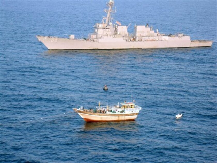 In this Jan. 5, 2012 photo released by the US Navy, the guided-missile destroyer USS Kidd (DDG 100) responds to a distress call from the master of the Iranian-flagged fishing dhow Al Molai, who claimed he was being held captive by pirates. Kidd's visit, board, search and seizure team, boarded and detained 15 suspected pirates, who were reportedly holding the 13-member Iranian crew hostage for the last two months. Kidd is conducting counter-piracy and maritime security operations while deployed to the U.S. 5th Fleet area of responsibility. U.S. military officials say the Navy has rescued an Iranian fishing boat that had been commandeered by suspected Somali pirates. The rescue Thursday comes amid escalating threats from Iran that it could block the Strait of Hormuz in response to stronger economic sanctions against Tehran over its disputed nuclear enrichment program.(AP Photo/ U.S. Navy)