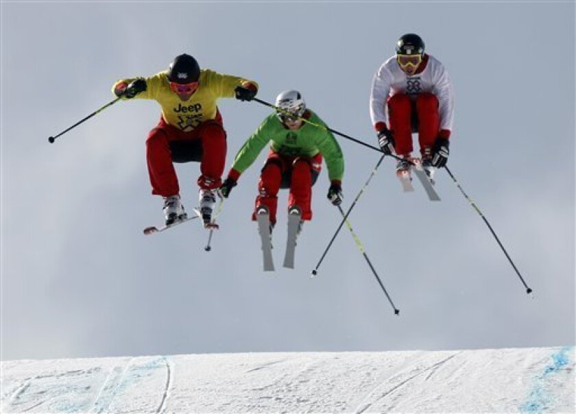 From left to right, Chris Del Bosco, of Vail, Colo., clears the final jump with Brady Laman of Canada, and Dave Duncan, also of Canada, in pursuit in the skier X finals at the Winter X Games at Buttermilk Mountain outside Aspen, Colo., on Sunday, Jan. 31, 2010. Del Bosco won while Laman finished in second place and Duncan placed in third. (AP Photo/David Zalubowski)