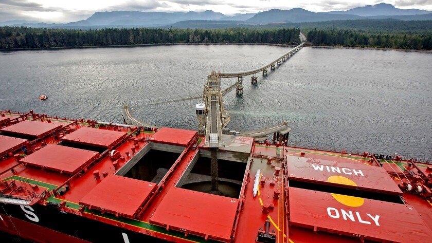 A conveyor belt carries gravel from the Orca quarry to a CSL bulk carrier ship off the coast of Port
