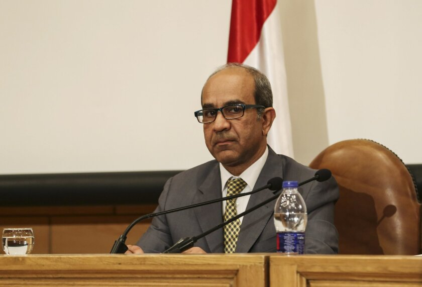 Ayman el-Muqadem, the head of the investigation team on a Russian plane crash last week in Egypt's Sinai, takes a seat before speaking at a press conference at the Aviation Ministry in the Nasr City neighborhood of Cairo, Egypt, Saturday, Nov. 7, 2015. El-Muqadem said a noise was heard in the last