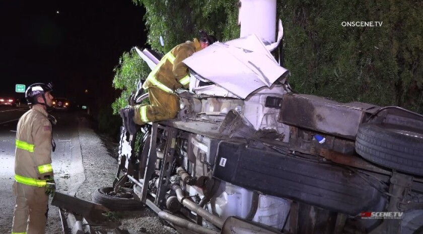Firefighters search the wreckage of a fatal crash late Wednesday night on Interstate 5 in Chula Vista.