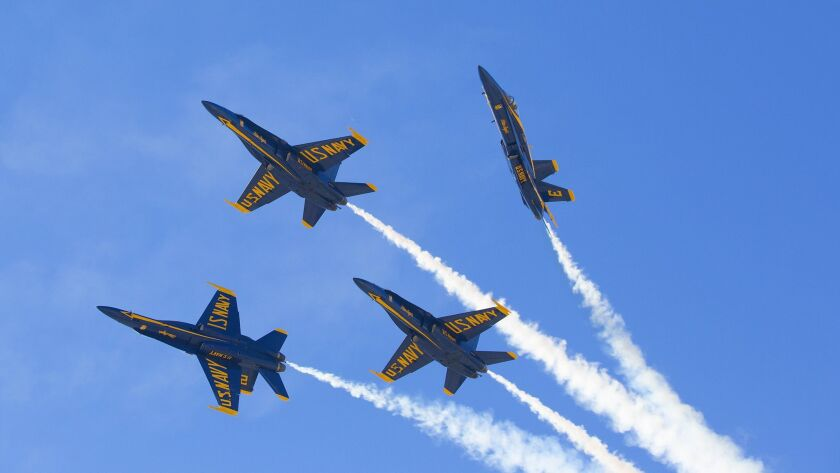 The Navy Blue Angels perform high-speed flight maneuvers for the crowd at the 2014 Miramar Air Show.