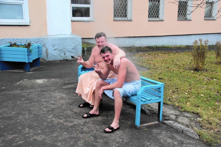 Two men take a break at a public banya in Petrozavodsk, Russia.