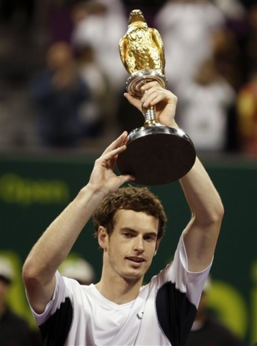 Britain's Andy Murray holds the trophy after winning the final of the ATP Qatar tennis open against Andy Roddick from the U.S. in Doha, Qatar, Saturday, Jan. 10, 2009. (AP Photo/Hassan Ammar)