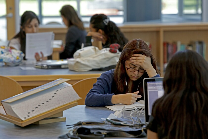Students read in the library at El Camino College Compton Center in Compton.