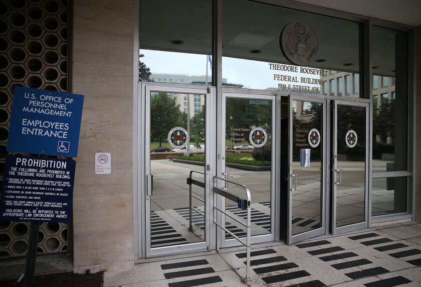 The entrance to the building that houses the Office of Personnel Management headquarters in Washington on June 5. U.S. investigators have said that at least 4 million current and former federal employees might have had their personal information stolen by Chinese hackers.