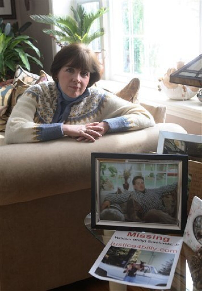 FILE- In a photo made March 17, 2007, Janice Smolinski poses in her Cheshire, Conn., home where a photo of her son, Billy, is visible in the foreground. Billy disappeared from his Waterbury, Conn. home in Aug. 2004 and Smolinski believes a Justice Department database program will someday help find her son who was 31 when he vanished. (AP Photo/Michelle McLoughlin, File)