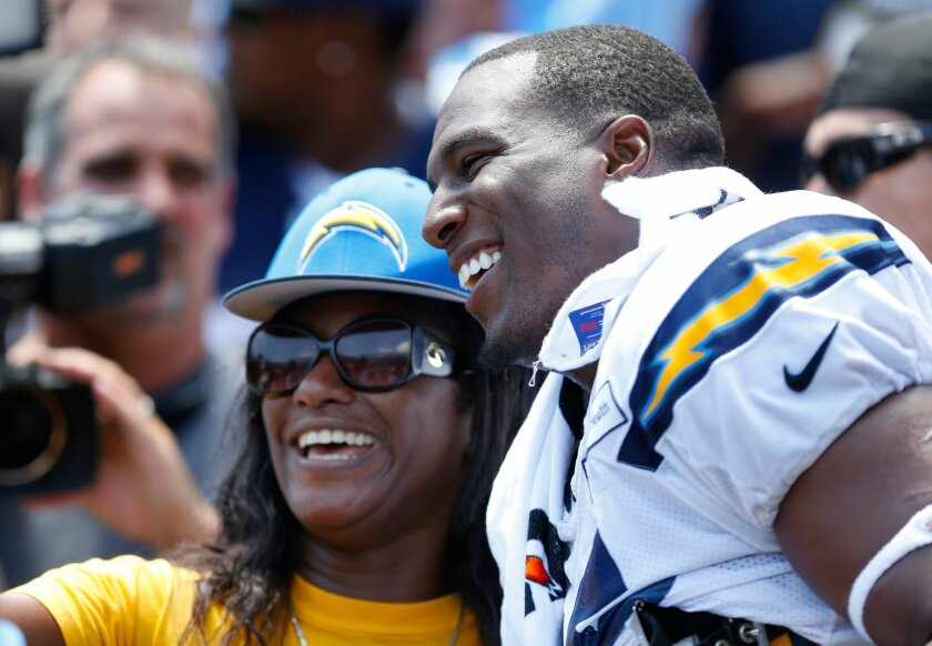 Jenae Buchanon takes a photo with Chargers tight end Antonio Gates after practice at the 2016 San Diego Chargers FanFest at Qualcomm Stadium.