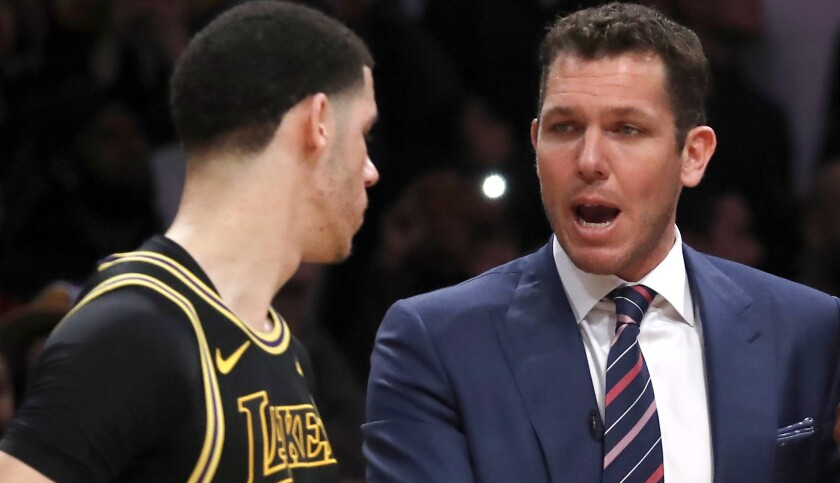 LOS ANGELES, CALIF. - MAR 16, 2018. Lakers coach Luke Walton huddles with guard Lonzo Ball, left,