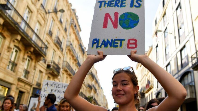 Demonstrators call for action to fight climate change during a march in Bordeaux, France, on Oct. 13.