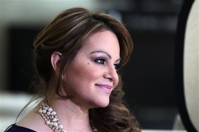 In this picture taken March 8, 2012, Mexican-American singer and reality TV star Jenni Rivera poses during an interview in Los Angeles. The California-born singer who rose through personal adversity to become a superstar adored by millions in a male-dominated genre of Mexican-American music, was co