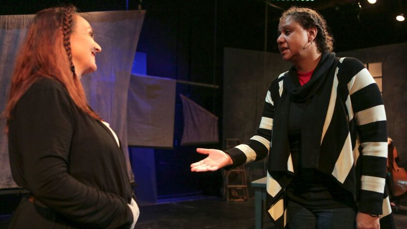 """Actor LInda Libby (left) and director Jacole Kitchen go over a rehearsal scene from """"An Iliad"""" at New Village Arts."""