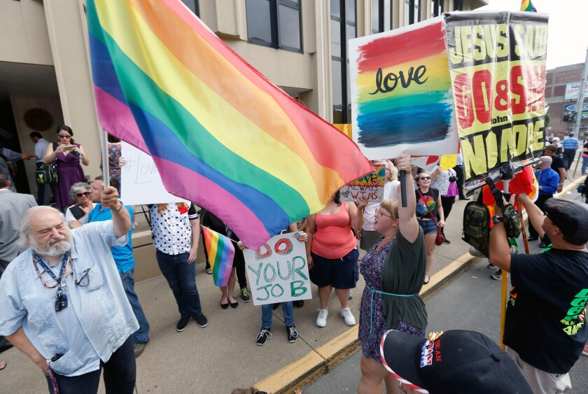 Hundreds yell, preach outside courthouse where marriage license case unfolds