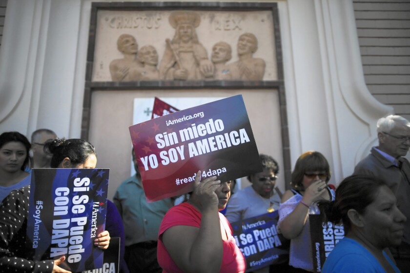 """A demonstrator in San Diego holds up a sign in Spanish that reads, """"Without fear, I am America."""""""
