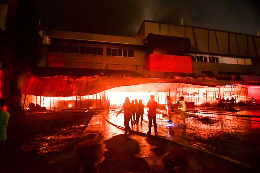 Firemen try to put out a fire in a mall following a quake in General Santos City, in the southern Philippines on Wednesday.