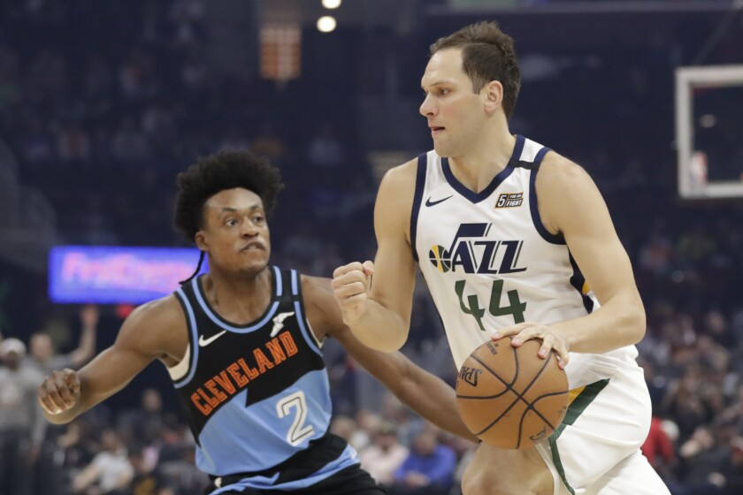 Utah Jazz's Bojan Bogdanovic (44) drives past Cleveland Cavaliers' Collin Sexton (2) in the first half of an NBA basketball game, Monday, March 2, 2020, in Cleveland. (AP Photo/Tony Dejak)
