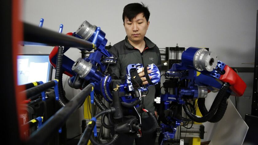 LOS ANGELES, CA - MAY 29, 2019: Yang Shen, a Ph D candidate in robotics at UCLA, demonstrates how th