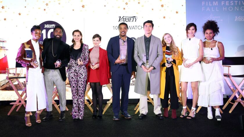 Letitia Wright, John David Washington, Marina De Tavira, Cailee Spaeny, Russell Hornsby, Henry Golding, Elsie Fisher, Gemma Chan and Zazie Beetz (from left) pose for a group photo onstage at the Newport Beach Film Festival Fall Honors and Variety's 10 Actors To Watch.