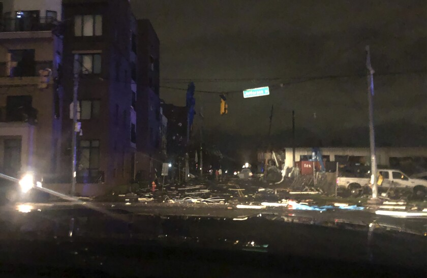 Debris scattered across an intersection Tuesday, March 3, 2020, in downtown Nashville, Tenn. The National Weather Service in Nashville confirmed a tornado touched down in the area. (Celia Darrough via AP)