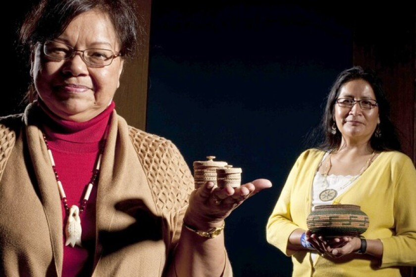 June Pardue, left, and Carol Emarthle-Douglas display items they made for an initial weekend marketplace.