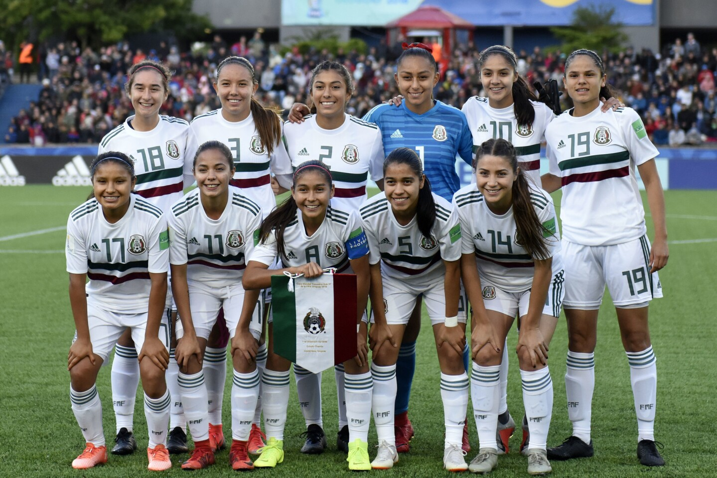 Mexico's players pose for the photo before the 2018 FIFA U-17 Women's World Cup final soccer match against Spain, in Montevideo, Uruguay, Saturday, Dec. 1, 2018. (AP Photo/Matilde Campodonico)