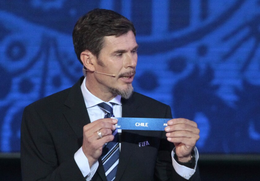 FILE - In this file photo dated Saturday, Nov. 26, 2016, Zvonimir Boban, FIFA's Deputy Secretary General for Football, holds the lot of Chile during the draw for the soccer Confederations Cup 2017, in Kazan, Russia. Former Croatia and AC Milan great Zvonimir Boban is returning to top level soccer politics as an advisor to UEFA president Aleksander Ceferin according to an announcement Friday April 16, 2021.(AP Photo/Ivan Sekretarev, FILE)