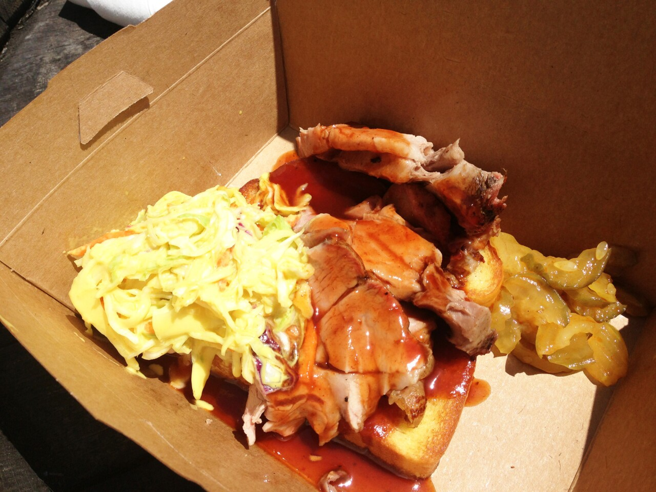 The Pork plate with Texas toast, spicy pickles and coleslaw.