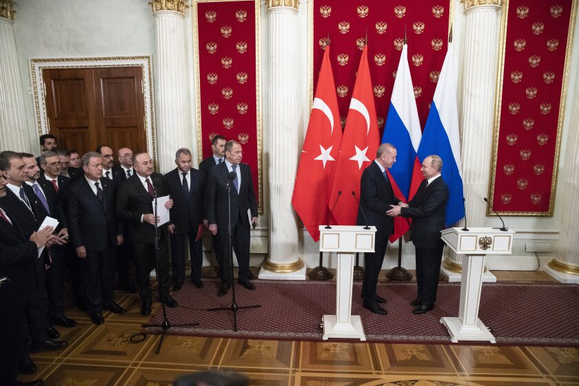 Russian President Vladimir Putin, right, and Turkish President Recep Tayyip Erdogan shake hands during a news conference after their talks in the Kremlin, in Moscow, Russia, Thursday, March 5, 2020. Russian President Vladimir Putin and his Turkish counterpart, Recep Tayyip Erdogan, say they have reached agreements that could end fighting in northwestern Syria. (AP Photo/Pavel Golovkin, Pool)