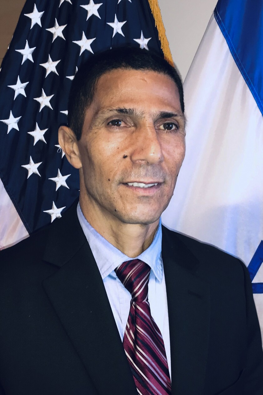 This November, 25, 2019 photo provided by the Israeli Foreign Ministry shows Israel's first Bedouin Arab diplomat Ishmael Khaldi in Miami, Florida. Khaldi who was once deployed abroad to push back against Israel's critics said he was beaten by overzealous security guards at Jerusalem's central bus station on Thursday, June 11, 2020. Khaldi said he believes it was a case of ethnic profiling. He said he filed a police complaint and went public with his experience in order to shine a light on racist behavior that he says exists in sectors of the country that he loves. (Israeli Consulate in Miami via AP)