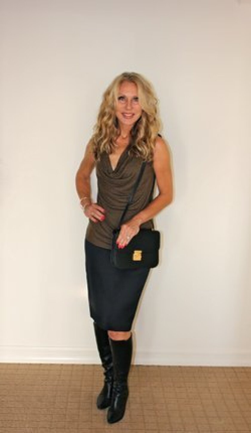 Marie Green wearing a Celine top, Chanel Skirt, Chanel boots and a Fendi handbag from The RealReal.com