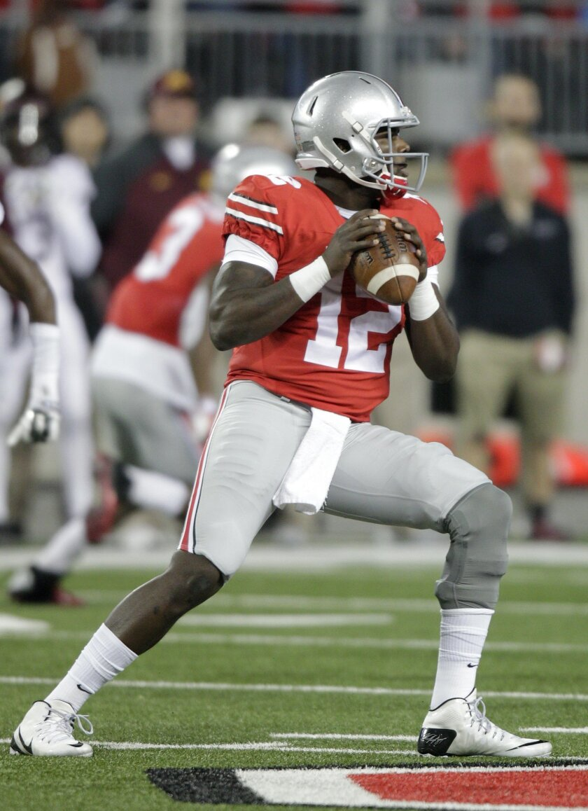 Ohio State quarterback Cardale Jones drops back to pass against Minnesota during the first quarter of an NCAA college football game Saturday, Nov. 7, 2015, in Columbus, Ohio. (AP Photo/Jay LaPrete)