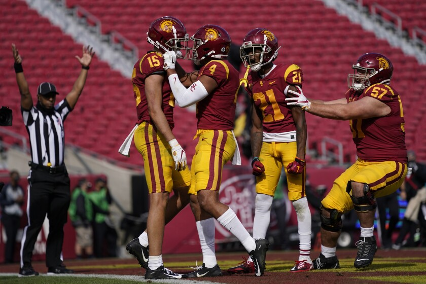 USC receiver Drake London celebrates with Bru McCoy, Tyler Vaughns and Justin Dedich after a touchdown catch.