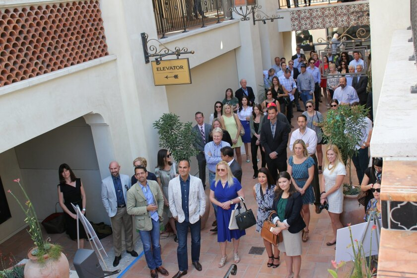 Guests mingle during the opening of the new La Plaza La Jolla center.
