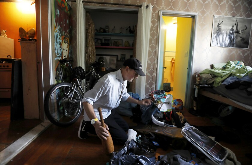 Peter James, 62, unpacks and organizes his new apartment in Los Angeles on March 19.