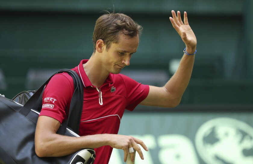 Russia's Daniil Medvedev waves after he lost his ATP Tour Singles, Men, 1st Round tennis match against Germany's Jan-Lennard Struff in Halle, Germany, Tuesday, June 15, 2021. (Friso Gentsch/dpa via AP)