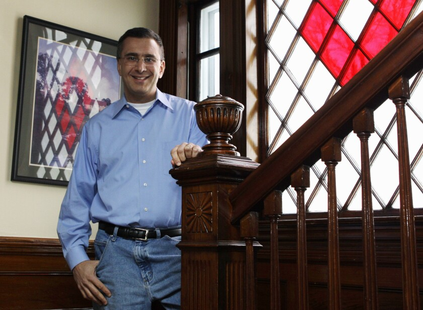 Man in the hot seat: In this Feb. 8, 2011 file photo, Jonathan Gruber poses in his home in Lexington, Mass.