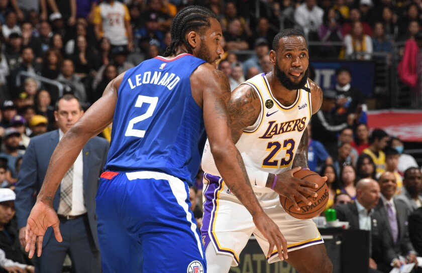 Clippers forward Kawhi Leonard guards Lakers forward LeBron James during a game on March 8.