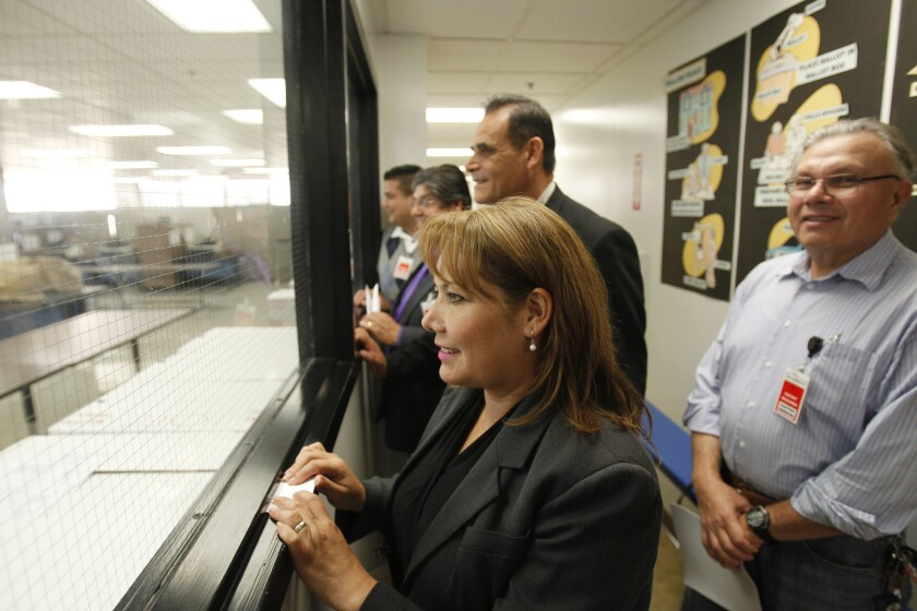Patty Lopez watches as ballots are counted in her 2014 race against then-incumbent Raul Bocanegra, who she bested by fewer than 500 votes.