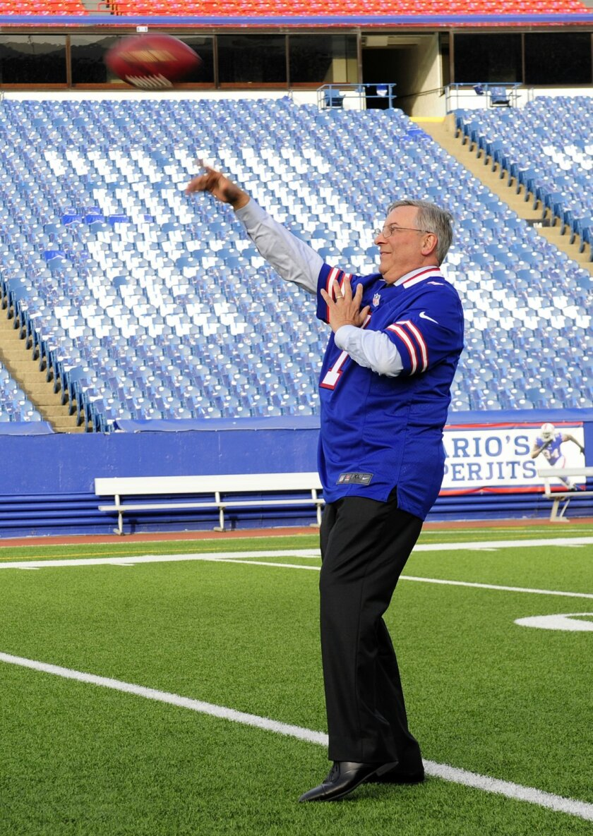 Terry Pegula, the new owner of the Buffalo Bills, throws a football downfield at Ralph Wilson Stadium in Orchard Park, N.Y., Friday, Oct. 10, 2014. (AP Photo/Gary Wiepert)
