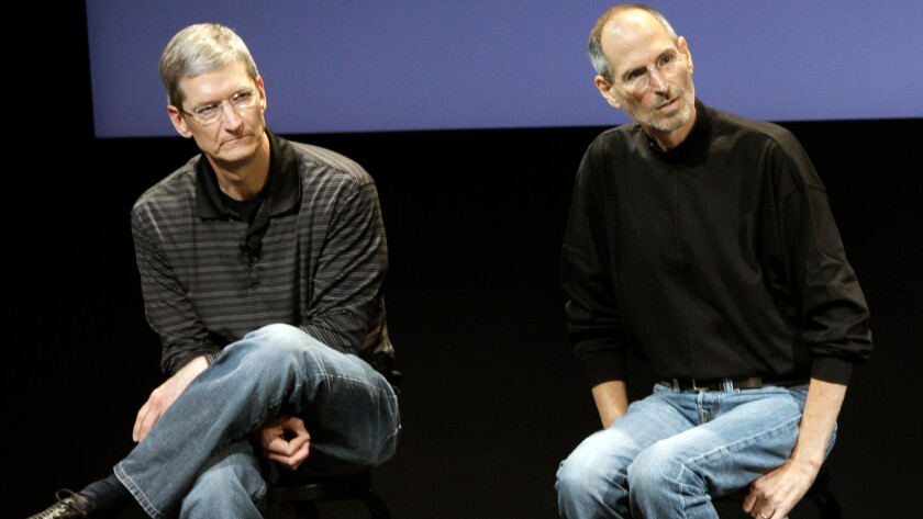 This July 16, 2010, file photo shows Apple's Tim Cook, left, and Steve Jobs, who died in 2011 after receiving a liver transplant that was credited with extending his life.