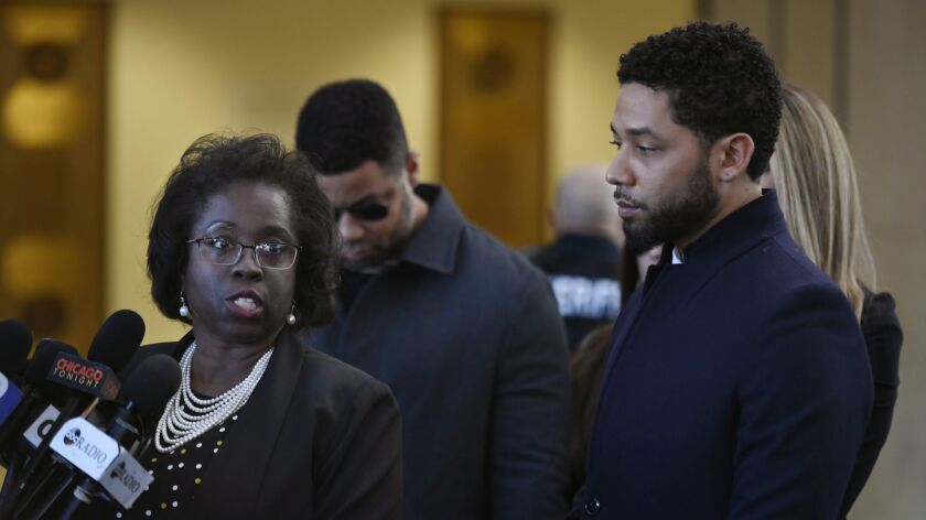 Actor Jussie Smollett, right, stands next to his attorney Patrica Brown Holmes during a news confere