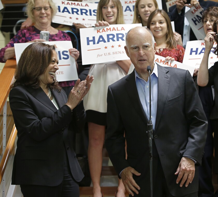 State Atty. Gen. Kamala Harris smiles and claps as Gov. Jerry Brown endorses her for the U.S. Senate.