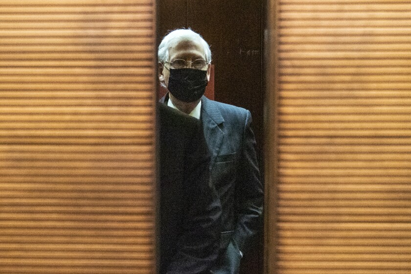 Senate Majority Leader Mitch McConnell wears a mask after a meeting on Capitol Hill.