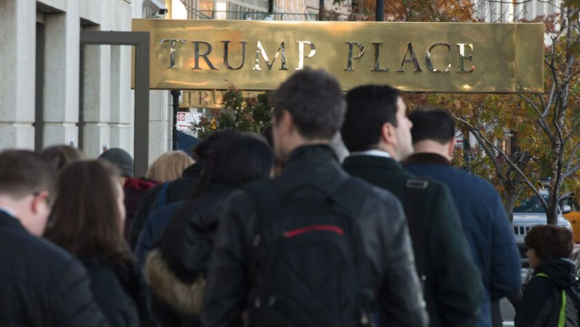 People stand in line outside a polling station at Trump Place in New York on Nov. 8, 2016.
