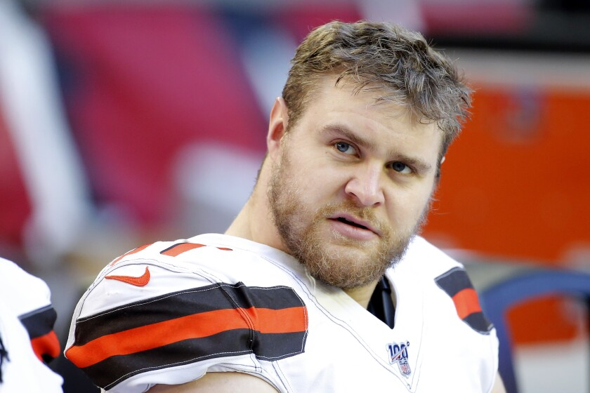 FILE - In this Dec. 15, 2019, file photo, Cleveland Browns defensive end Porter Gustin watches from the bench during an NFL football game against the Arizona Cardinals in Glendale, Ariz. The Browns placed Gustin on the COVID-19 list, further weakening a group already without star Myles Garrett. (AP Photo/Rick Scuteri, File)