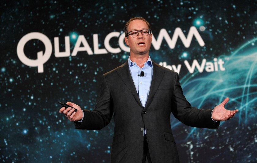 Qualcomm President Derek Aberle, shown here CES in January, heads the company's technology licensing business. The wireless chip maker will pay $975 million in a settlement with China's anti-monopoly regulator.