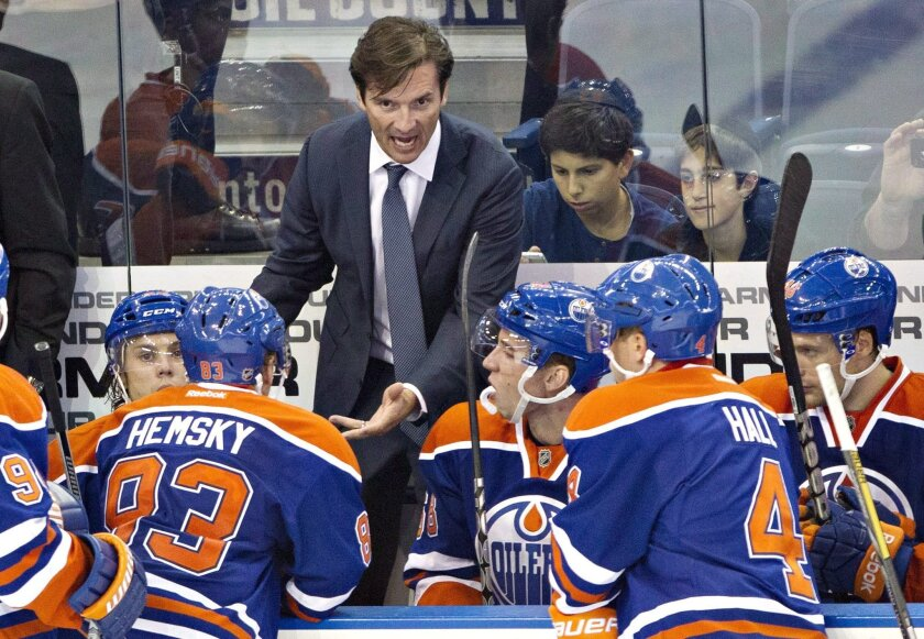 FILE - In this Sept. 24, 2013, file photo, Edmonton Oilers head coach Dallas Eakins talks to his players while playing the New York Rangers during third period NHL preseason hockey action in Edmonton, Alberta. Dallas Eakins has been fired as coach of the Edmonton Oilers, who have lost 15 of 16 game