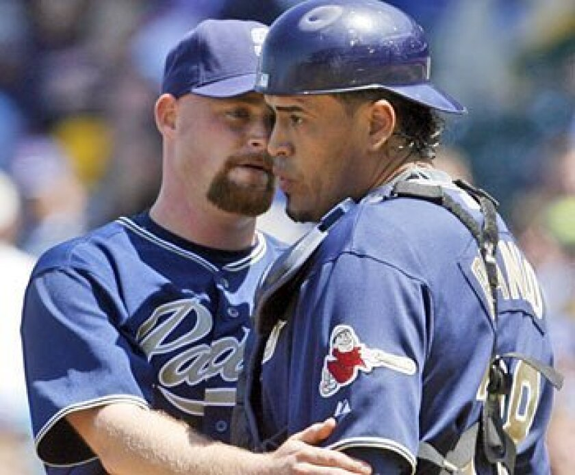Padres pitcher Chad Gaudin confers with catcher Henry Blanco. (Associated Press)